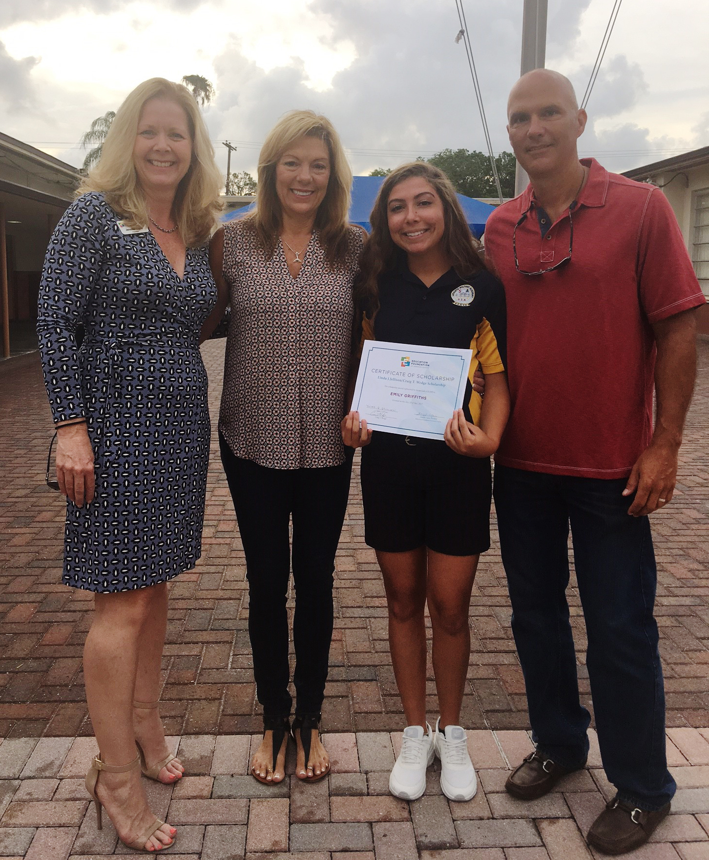 Emily Griffiths accepts scholarship certificate