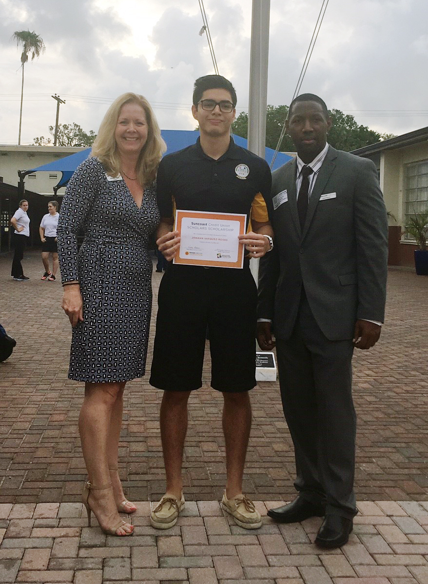 Johann Vazquez-Reosas accepts his scholarship certificate